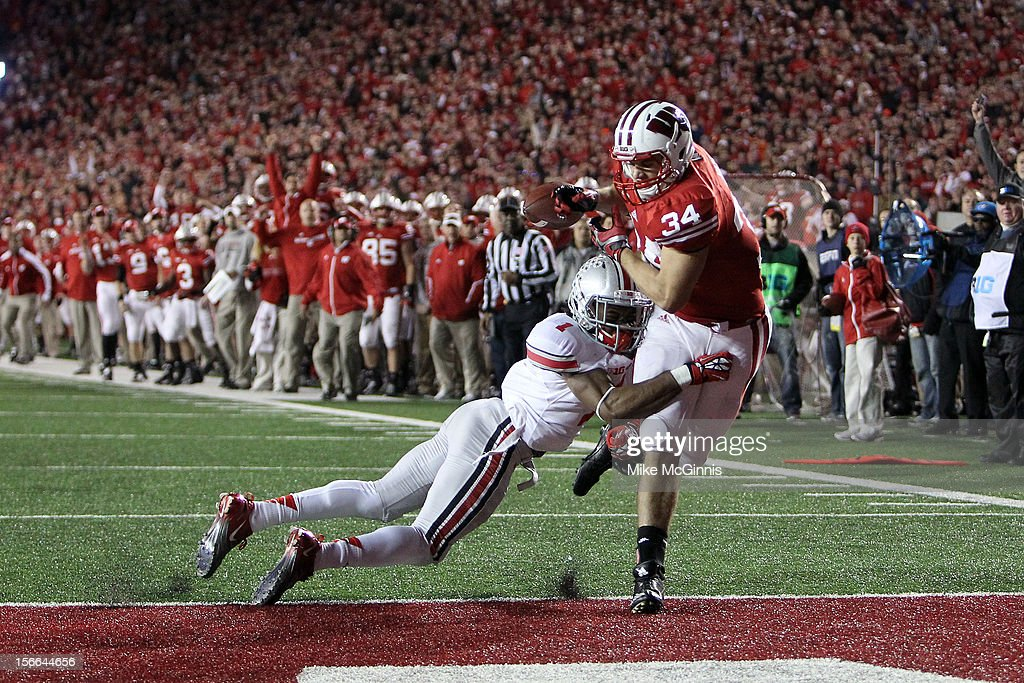 Derek Watt #34 of the Wisconsin Badgers makes the catch but is quickly hit by Bradley Roby #1 of the Ohio State Buckeyes which ended in a incomplete pass during the game at Camp Randall Stadium on November 17, 2012 in Madison, Wisconsin.