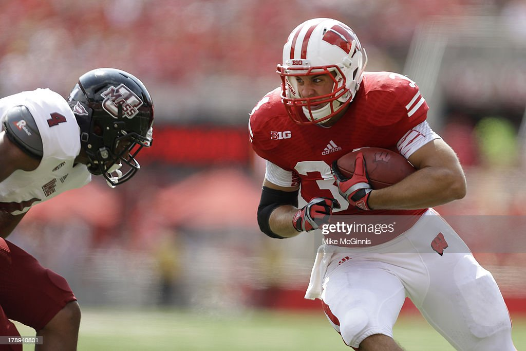 Derek Watt #34 of the Wisconsin Badgers run upfield before getting tackled by Randall Jette #4 of the UMass Minutemen during the game at Camp Randall Stadium on August 31, 2013 in Madison, Wisconsin.