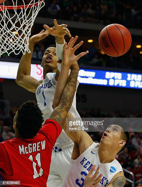 Derek Willis and Skal Labissiere of the Kentucky Wildcats reject a shot by Rayshaun McGrew of the Stony Brook Seawolves in the first half during the...