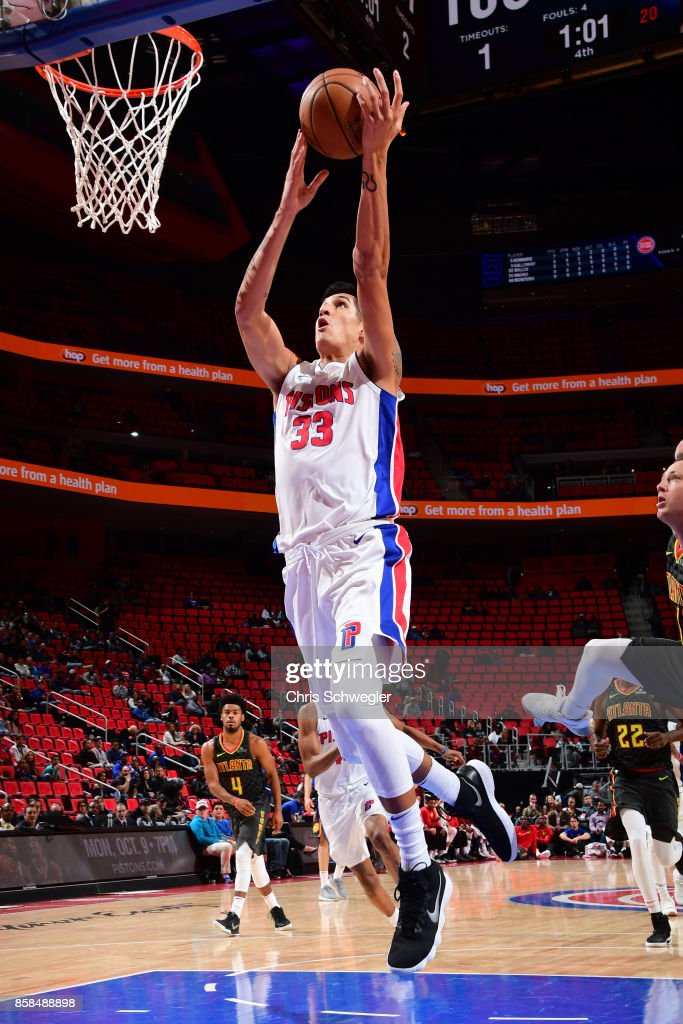 Derek Willis #33 of the Detroit Pistons goes to the basket against the Atlanta Hawks on October 6, 2017 at Little Caesars Arena in Detroit, Michigan.