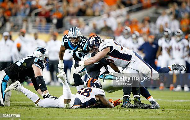 Derek Wolfe and Danny Trevathan of the Denver Broncos sack Cam Newton of the Carolina Panthers in the third quarter during Super Bowl 50 at Levi's...