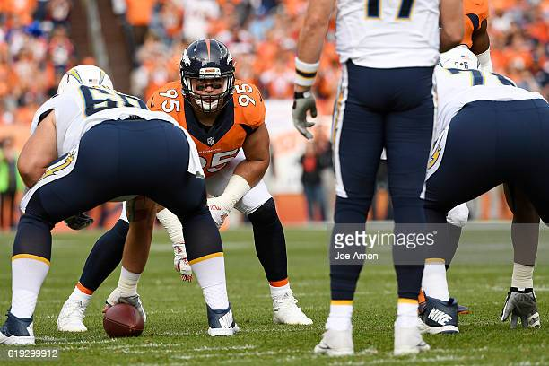 Derek Wolfe of the Denver Broncos eyeballs Philip Rivers of the San Diego Chargers before he takes the snap during the first quarter on Sunday...