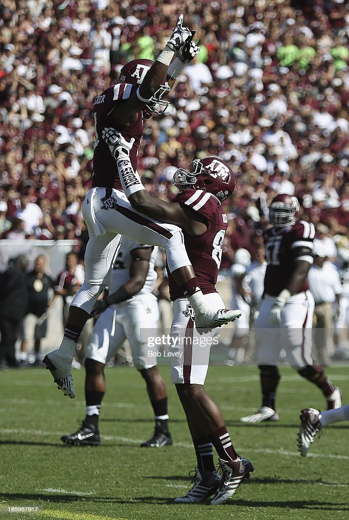 Derel Walker #11 of the Texas A&M Aggies celebrates with Nehemiah Hicks #81 of the Texas A&M Aggies after scoring against the Vanderbilt Commodores at Kyle Field on October 26, 2013 in College Station, Texas.