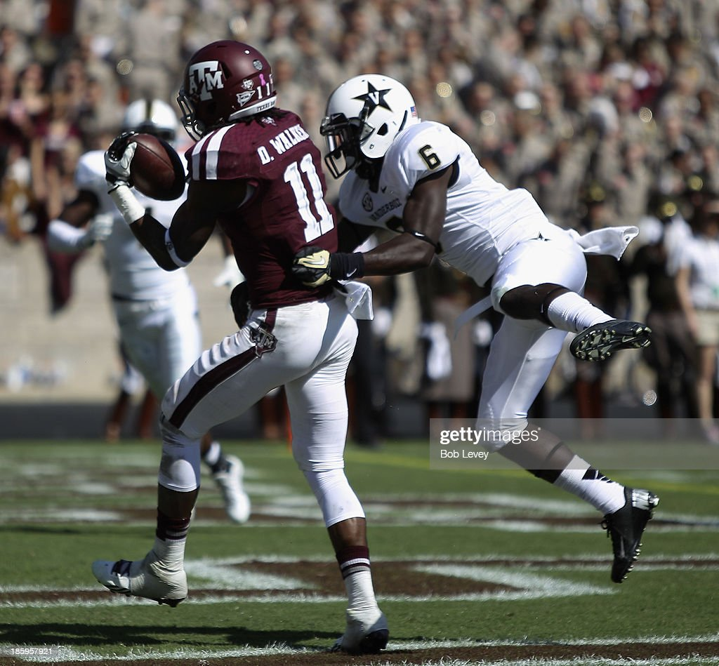 Derel Walker #11 of the Texas A&M Aggies grabs a pass from Darrius Sims #6 of the Vanderbilt Commodores at Kyle Field on October 26, 2013 in College Station, Texas.