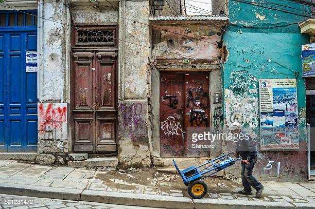 Derelict buildings and person on his own