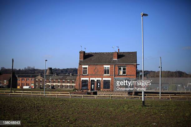 A derelict factory and empty houses wait to be demolished on February 1 2012 in StokeOnTrent England Staffordshire has borne the brunt of the...