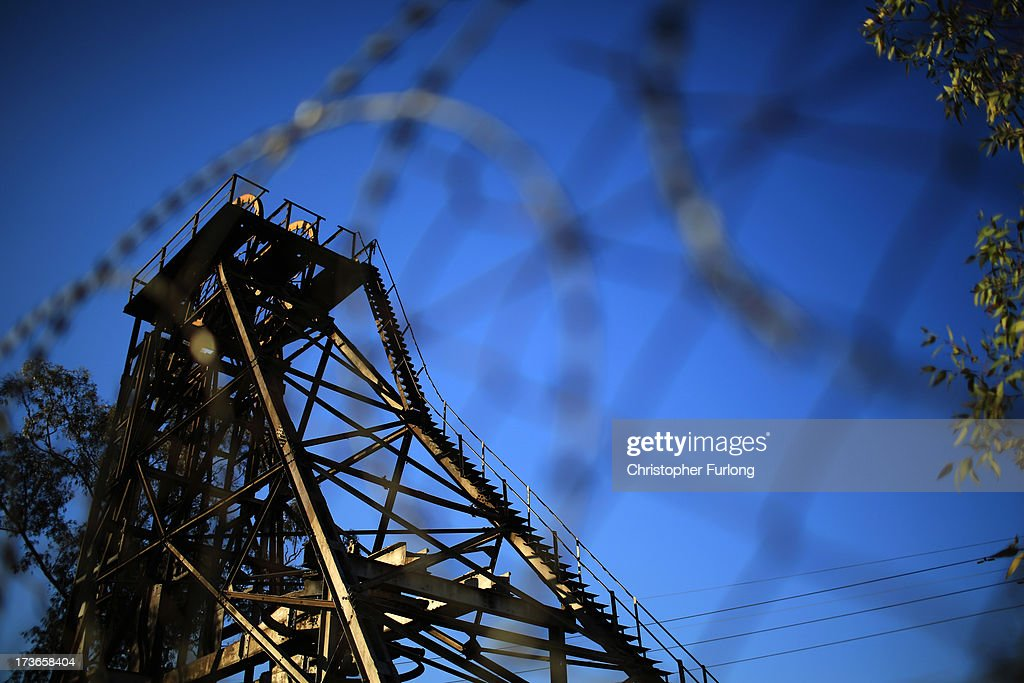 A derelict gold mine shaft's winding gear is seen on July 16, 2013 in Johannesburg, South Africa. Johannesburg became the centre of gold mining in 1886 when gold was first discovered. Two government officials were sent to establish a settlement and named it Johannesburg after the first name they both shared. The gold rush lasted for over 100 years. The South African mining industry has shed more than 340,000 jobs since 1990 but is still the fifth largest gold producer in the world and has vast amounts of other minerals still to be unearthed.