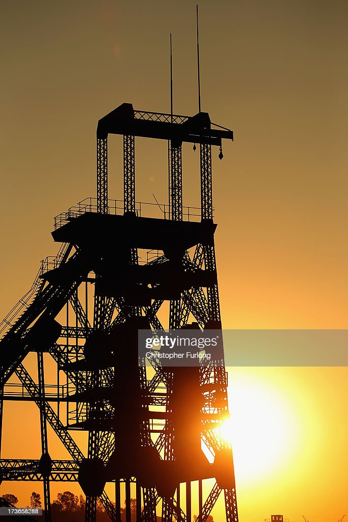 A derelict gold mine shaft's winding gear sits in front of the setting sun on July 15, 2013 in Johannesburg, South Africa. Johannesburg became the centre of gold mining in 1886 when gold was first discovered. Two government officials were sent to establish a settlement and named it Johannesburg after the first name they both shared. The gold rush lasted for over 100 years. The South African mining industry has shed more than 340,000 jobs since 1990 but is still the fifth largest gold producer in the world and has vast amounts of other minerals still to be unearthed.