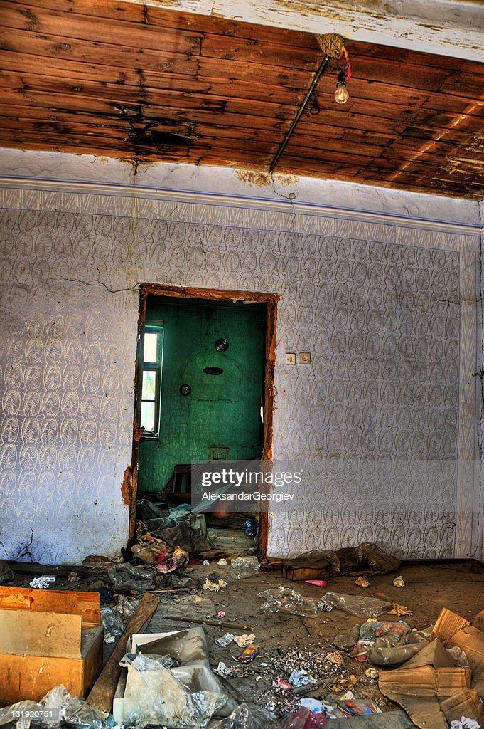 Derelict Old Dirty Bedroom With Door And Window Stock Photo