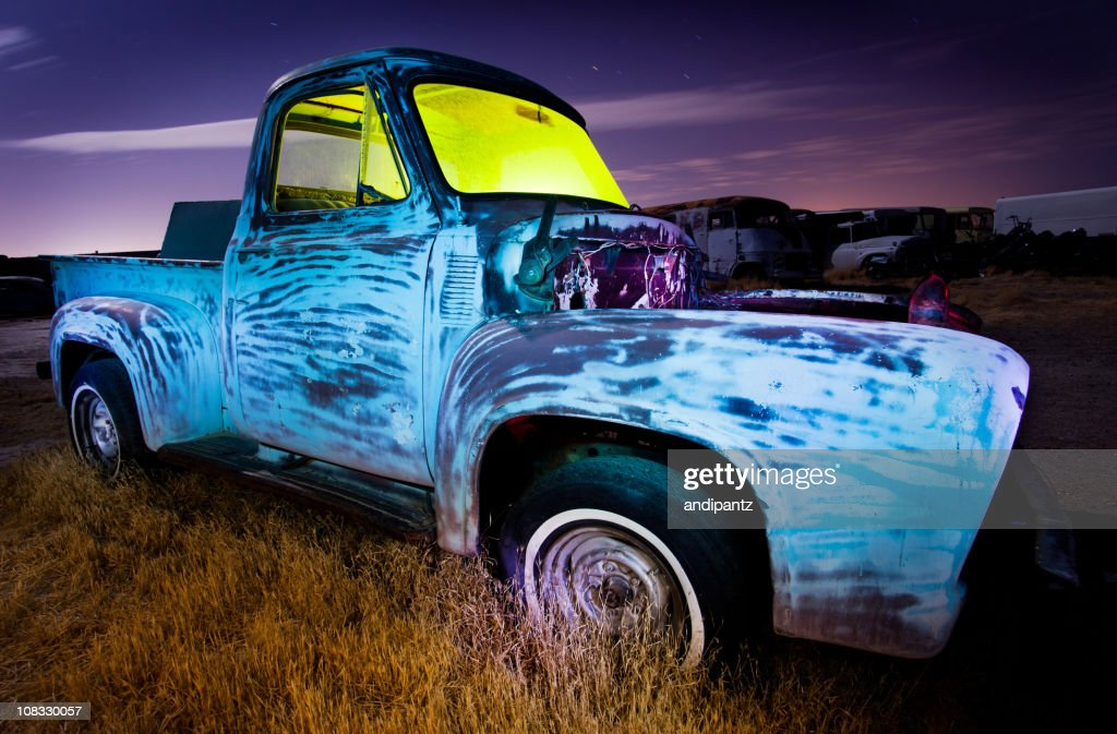 Derelict pickup truck at night : Stock Photo