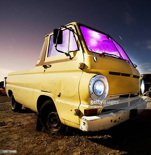 Derelict pickup truck at night