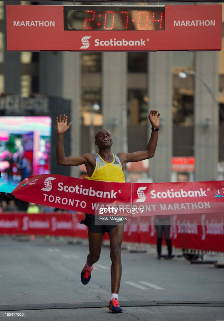TORONTO - OCTOBER 20 - Deressa Chimsa, of Ethiopia, crosses the finish line in a course record time. Scotiabank Toronto Waterfront Marathon takes over the majority of the downtown as 25,000 runners take part in the annual event which raises money for over 180 local charities. October 20, 2013.