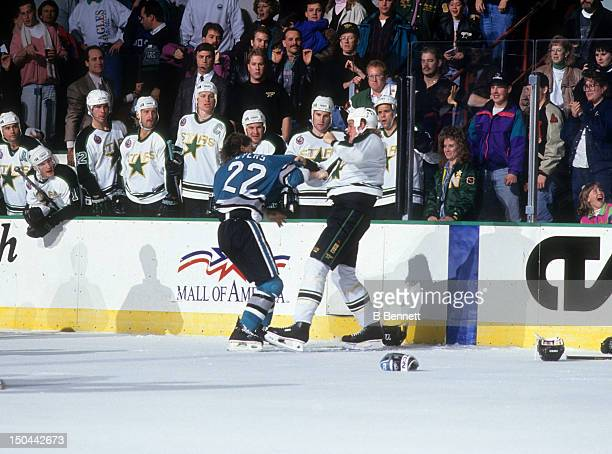Derian Hatcher of the Minnesota North Stars fights with Lyndon Byers of the San Jose Sharks on December 28 1992 at the Met Center in Bloomington...