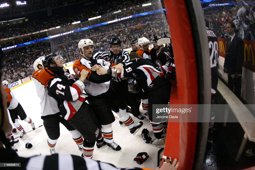 Derian Hatcher of the Philadelphia Flyers tussles with Sabres' Derek Roy during game two playoffs action versus the Buffalo Sabres at the HSBC Arena...