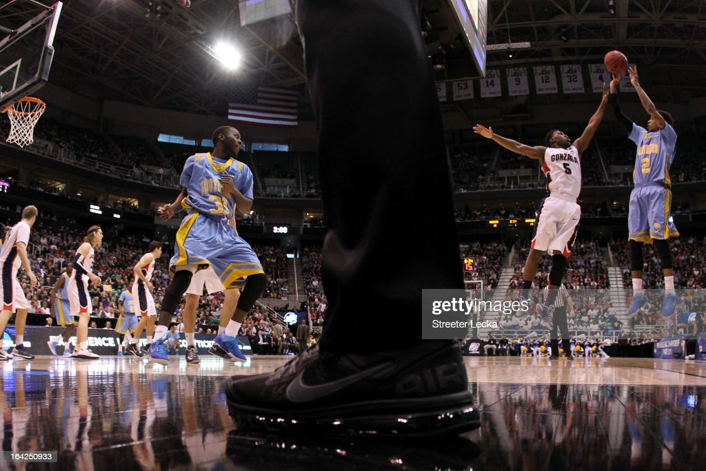 Derick Beltran of the Southern University Jaguars shoots over Gary Bell Jr #5 of the Gonzaga Bulldogs during the second round of the 2013 NCAA Men's...