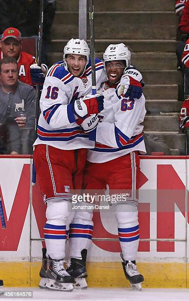 Derick Brassard and Anthony Duclair of the New York Rangers celebrate Duclair's goal in the first period against the Chicago Blackhakws during a...