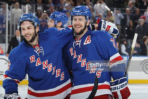 Derick Brassard and Derek Stepan of the New York Rangers celebrate after winning in overtime 21 to advance to the Eastern Conference Finals against...