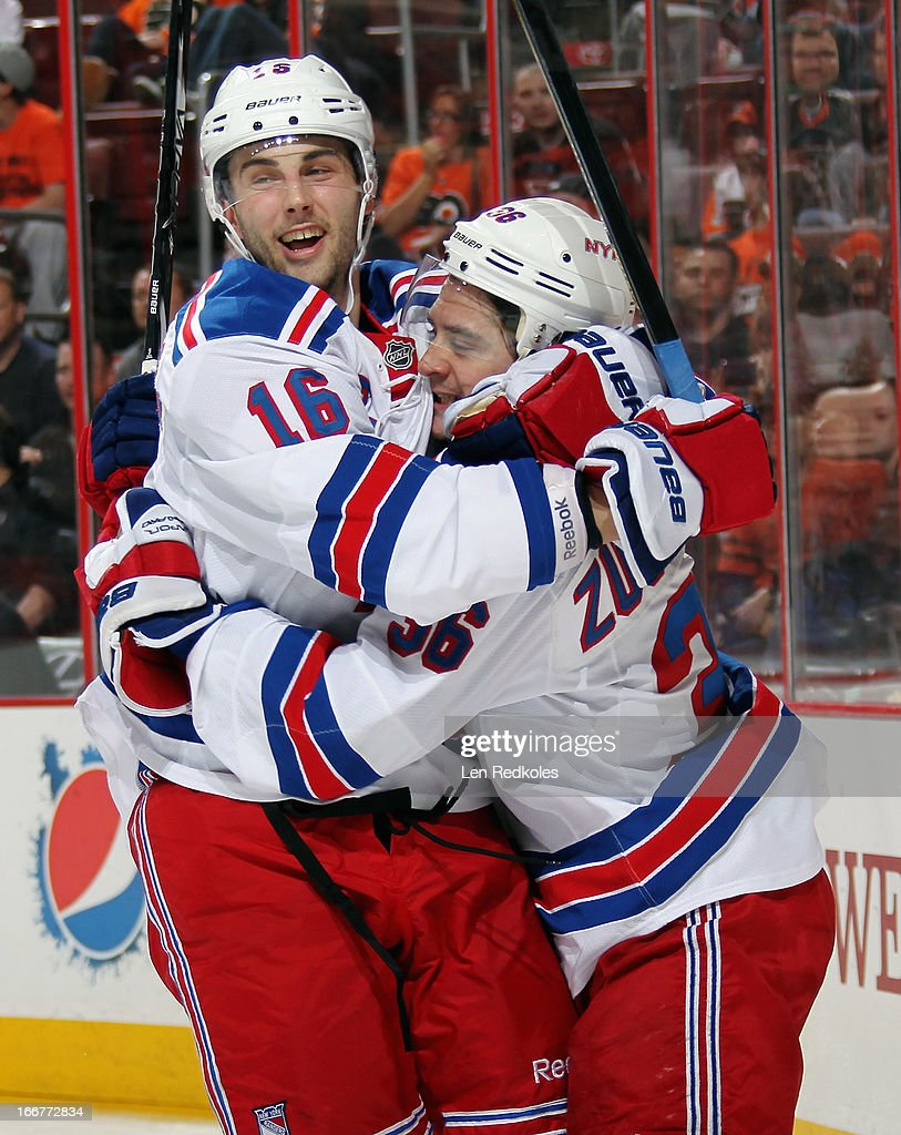<a gi-track='captionPersonalityLinkClicked' href=/galleries/search?phrase=Derick+Brassard&family=editorial&specificpeople=540468 ng-click='$event.stopPropagation()'>Derick Brassard</a> #16 and <a gi-track='captionPersonalityLinkClicked' href=/galleries/search?phrase=Mats+Zuccarello&family=editorial&specificpeople=7219903 ng-click='$event.stopPropagation()'>Mats Zuccarello</a> #36 of the New York Rangers celebrate Zuccarello's second period goal against the Philadelphia Flyers on April 16, 2013 at the Wells Fargo Center in Philadelphia, Pennsylvania.