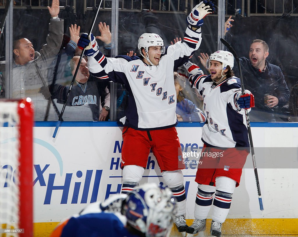 <a gi-track='captionPersonalityLinkClicked' href=/galleries/search?phrase=Derick+Brassard&family=editorial&specificpeople=540468 ng-click='$event.stopPropagation()'>Derick Brassard</a> #16 and <a gi-track='captionPersonalityLinkClicked' href=/galleries/search?phrase=Mats+Zuccarello&family=editorial&specificpeople=7219903 ng-click='$event.stopPropagation()'>Mats Zuccarello</a> #36 of the New York Rangers celebrate after a third period goal against the New York Islanders at Madison Square Garden on January 31, 2014 in New York City.
