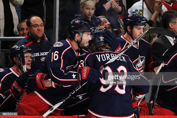 Derick Brassard congratulates Jakub Voracek both of the Columbus Blue Jackets after Voracek scored a goal on a penalty shot against the Chicago...