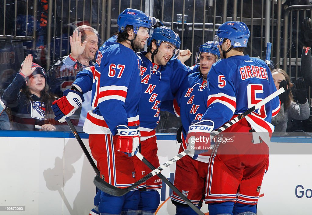 <a gi-track='captionPersonalityLinkClicked' href=/galleries/search?phrase=Derick+Brassard&family=editorial&specificpeople=540468 ng-click='$event.stopPropagation()'>Derick Brassard</a> #16, Dan Girardi #5, <a gi-track='captionPersonalityLinkClicked' href=/galleries/search?phrase=Benoit+Pouliot&family=editorial&specificpeople=879830 ng-click='$event.stopPropagation()'>Benoit Pouliot</a> #67 and <a gi-track='captionPersonalityLinkClicked' href=/galleries/search?phrase=Mats+Zuccarello&family=editorial&specificpeople=7219903 ng-click='$event.stopPropagation()'>Mats Zuccarello</a> #36 of the New York Rangers celebrate after a third-period goal against the Colorado Avalanche at Madison Square Garden on February 4, 2014 in New York City.