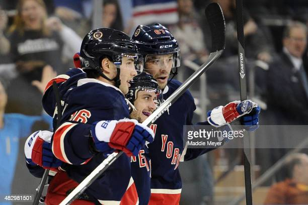 Derick Brassard Mats Zuccarello and Benoit Pouliot of the New York Rangers celebrate after Zuccarello's second goal in the second period at Madison...