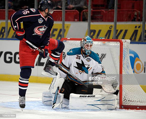 Derick Brassard of Columbus Blue in action against David Leneveu of San Jose Sharks during the 2010 Compuware NHL Premiere game between Columbus Blue...