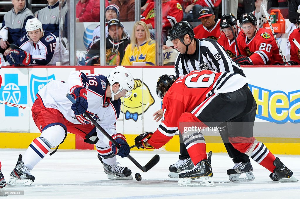 <a gi-track='captionPersonalityLinkClicked' href=/galleries/search?phrase=Derick+Brassard&family=editorial&specificpeople=540468 ng-click='$event.stopPropagation()'>Derick Brassard</a> #16 of the Columbus Blue Jackets and <a gi-track='captionPersonalityLinkClicked' href=/galleries/search?phrase=Michael+Frolik&family=editorial&specificpeople=537965 ng-click='$event.stopPropagation()'>Michael Frolik</a> #67 of the Chicago Blackhawks fight for the puck during a face-off during the NHL game on February 24, 2013 at the United Center in Chicago, Illinois.