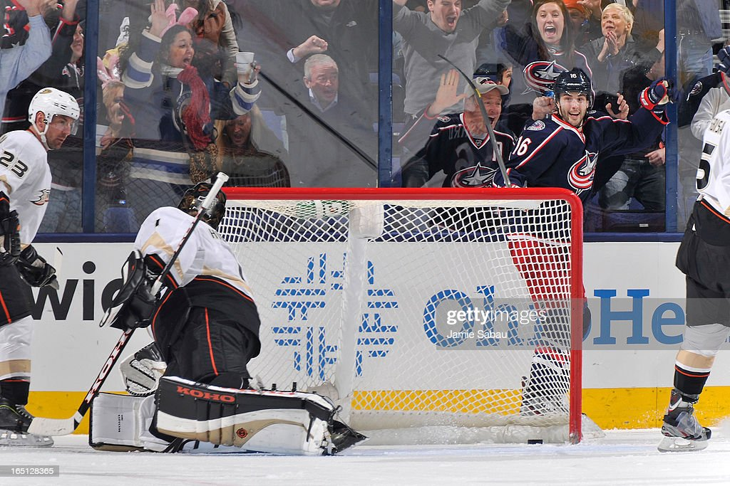 <a gi-track='captionPersonalityLinkClicked' href=/galleries/search?phrase=Derick+Brassard&family=editorial&specificpeople=540468 ng-click='$event.stopPropagation()'>Derick Brassard</a> #16 of the Columbus Blue Jackets celebrates after scoring on goaltender <a gi-track='captionPersonalityLinkClicked' href=/galleries/search?phrase=Jonas+Hiller&family=editorial&specificpeople=743364 ng-click='$event.stopPropagation()'>Jonas Hiller</a> #1 of the Anaheim Ducks during the second period on March 31, 2013 at Nationwide Arena in Columbus, Ohio.