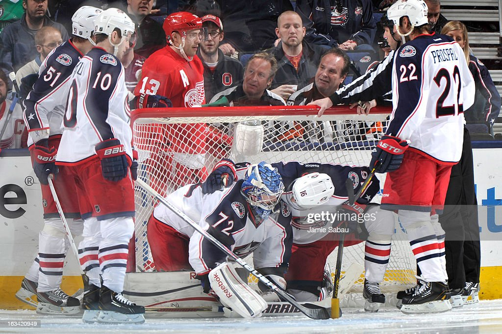 <a gi-track='captionPersonalityLinkClicked' href=/galleries/search?phrase=Derick+Brassard&family=editorial&specificpeople=540468 ng-click='$event.stopPropagation()'>Derick Brassard</a> #16 of the Columbus Blue Jackets checks on goaltender <a gi-track='captionPersonalityLinkClicked' href=/galleries/search?phrase=Sergei+Bobrovsky&family=editorial&specificpeople=4488556 ng-click='$event.stopPropagation()'>Sergei Bobrovsky</a> #72 of the Columbus Blue Jackets after sliding into him during the third period on March 9, 2013 at Nationwide Arena in Columbus, Ohio. Columbus defeated Detroit 3-0.