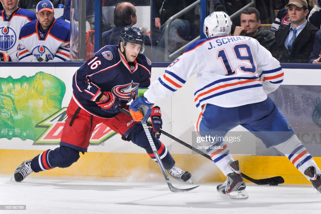 <a gi-track='captionPersonalityLinkClicked' href=/galleries/search?phrase=Derick+Brassard&family=editorial&specificpeople=540468 ng-click='$event.stopPropagation()'>Derick Brassard</a> #16 of the Columbus Blue Jackets controls the puck as Justin Schultz #19 of the Edmonton Oilers defends in the third period on March 5, 2013 at Nationwide Arena in Columbus, Ohio. Columbus defeated Edminton 4-3 in a shootout.
