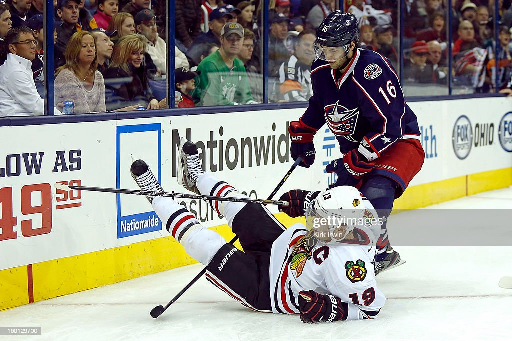 Derick Brassard #16 of the Columbus Blue Jackets gets called for tripping Jonathan Toews #19 of the Chicago Blackhawks while on the power play during the third period on January 26, 2013 at Nationwide Arena in Columbus, Ohio. Chicago defeated Columbus 3-2.