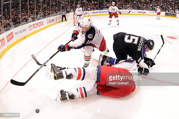 Derick Brassard of the Columbus Blue Jackets reaches for the puck against Brad Richardson of the Los Angeles Kings at Staples Center on November 17...