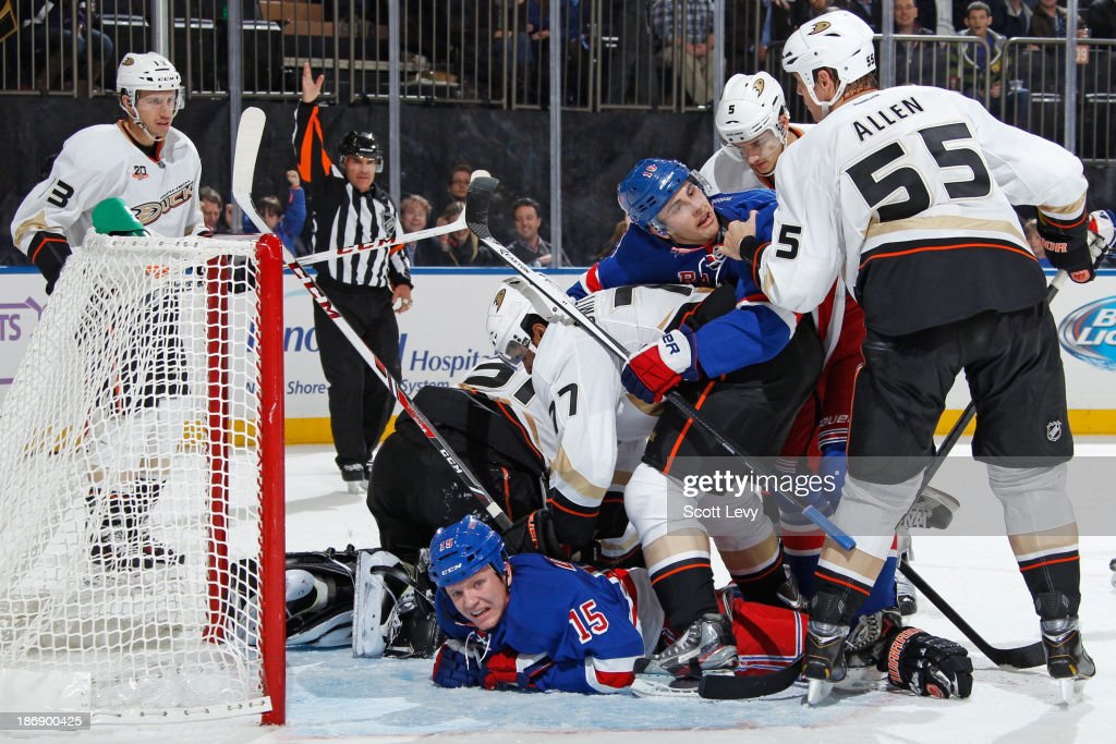 <a gi-track='captionPersonalityLinkClicked' href=/galleries/search?phrase=Derick+Brassard&family=editorial&specificpeople=540468 ng-click='$event.stopPropagation()'>Derick Brassard</a> #16 of the New York Rangers and <a gi-track='captionPersonalityLinkClicked' href=/galleries/search?phrase=Bryan+Allen+-+Ice+Hockey+Player&family=editorial&specificpeople=206454 ng-click='$event.stopPropagation()'>Bryan Allen</a> #55 of the Anaheim Ducks battle for position in front of the net at Madison Square Garden on November 4, 2013 in New York City.