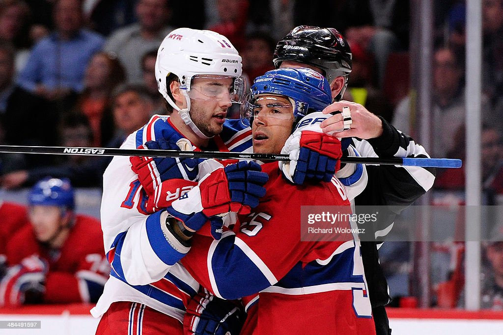 Derick Brassard #16 of the New York Rangers and Francis Bouillon #55 of the Montreal Canadiens exchange words during the NHL game at the Bell Centre on April 12, 2014 in Montreal, Quebec, Canada. The Canadiens defeated the Rangers 1-0 in overtime.