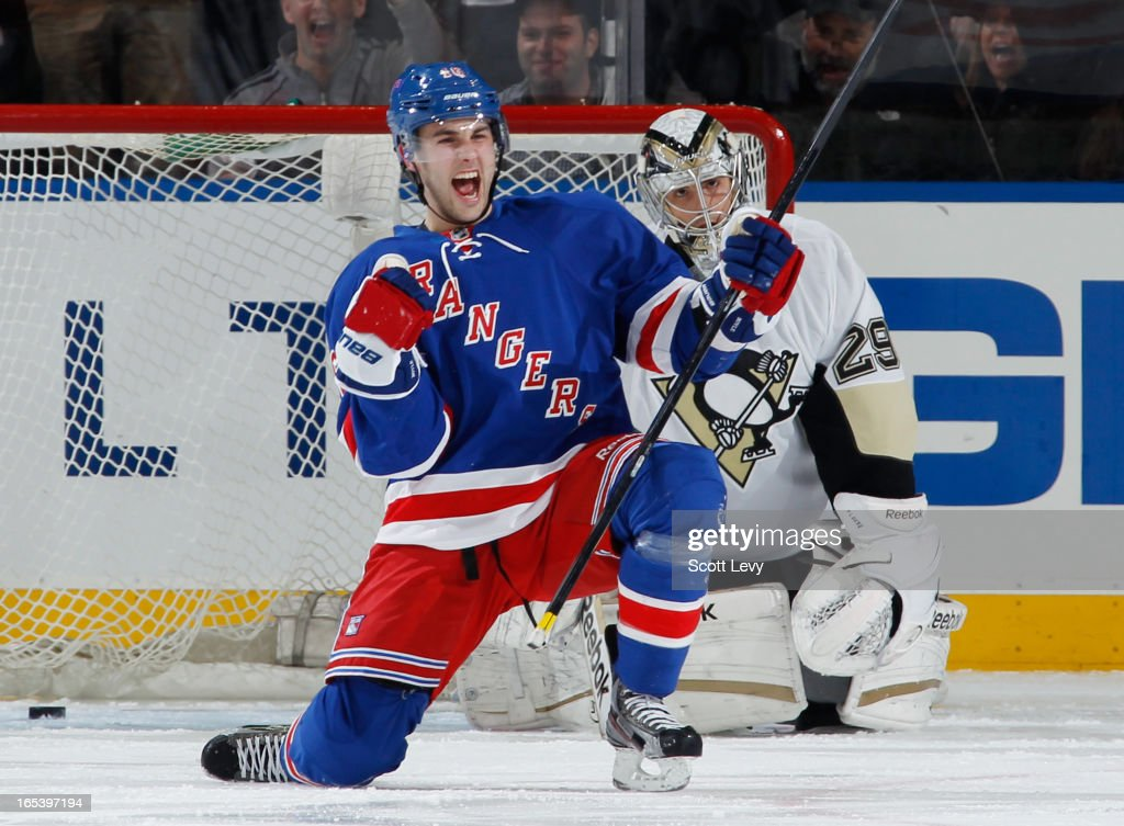 <a gi-track='captionPersonalityLinkClicked' href=/galleries/search?phrase=Derick+Brassard&family=editorial&specificpeople=540468 ng-click='$event.stopPropagation()'>Derick Brassard</a> #16 of the New York Rangers celebrates his goal in the second period against <a gi-track='captionPersonalityLinkClicked' href=/galleries/search?phrase=Marc-Andre+Fleury&family=editorial&specificpeople=233779 ng-click='$event.stopPropagation()'>Marc-Andre Fleury</a> #29 of the Pittsburgh Penguins at Madison Square Garden on April 3, 2013 in New York City.