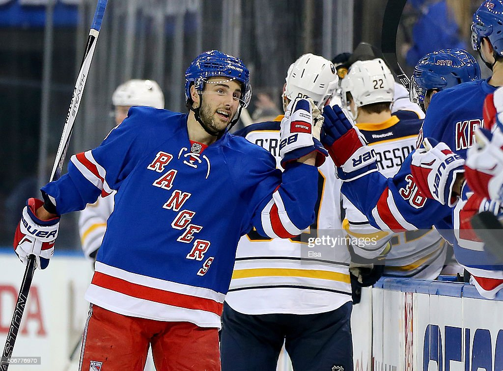 Derick Brassard of the New York Rangers celebrates his goal with teammates on the bench in the third period against the Buffalo Sabres at Madison...