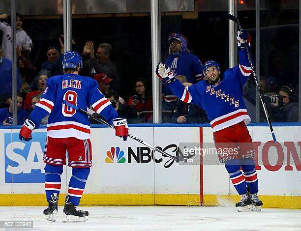 Derick Brassard of the New York Rangers celebrates his goal with teammate Kevin Klein in the third period against the Buffalo Sabres at Madison...