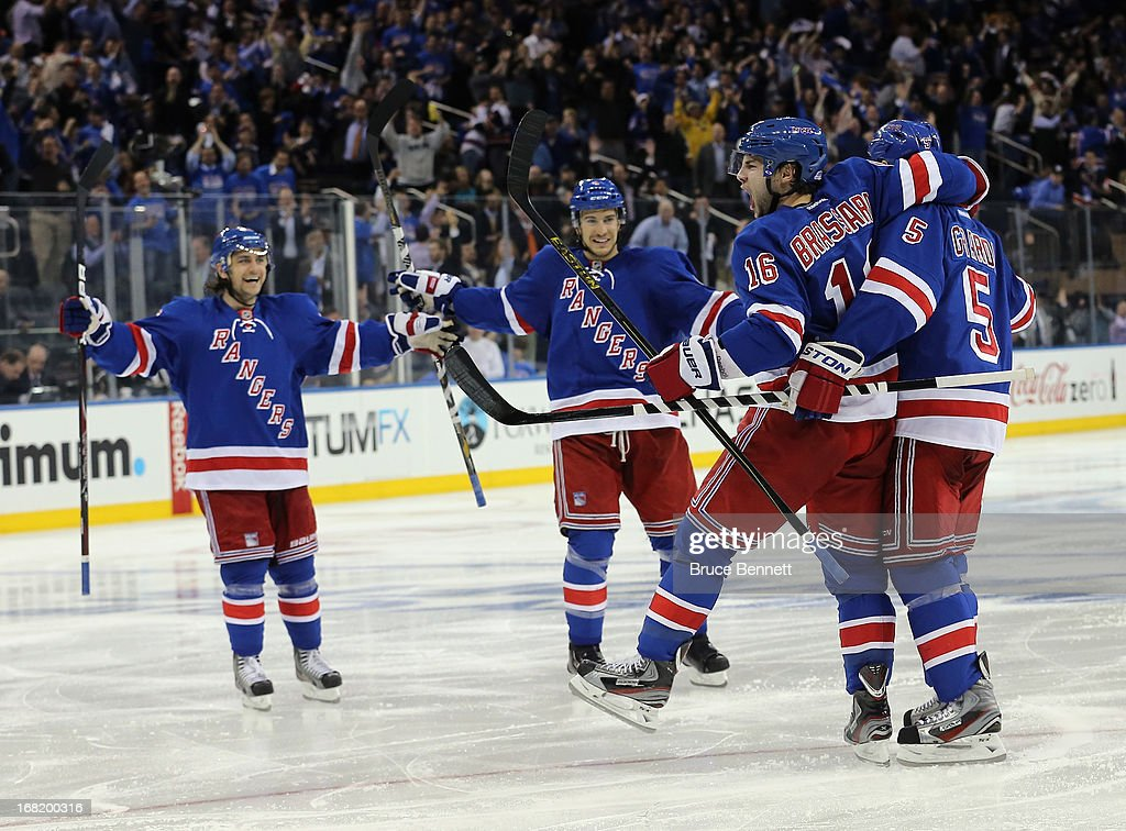 <a gi-track='captionPersonalityLinkClicked' href=/galleries/search?phrase=Derick+Brassard&family=editorial&specificpeople=540468 ng-click='$event.stopPropagation()'>Derick Brassard</a> #16 of the New York Rangers celebrates his powerplay goal at 1:23 of the second period in Game Three of the Eastern Conference Quarterfinals during the 2013 NHL Stanley Cup Playoffs at Madison Square Garden on May 6, 2013 in New York City.