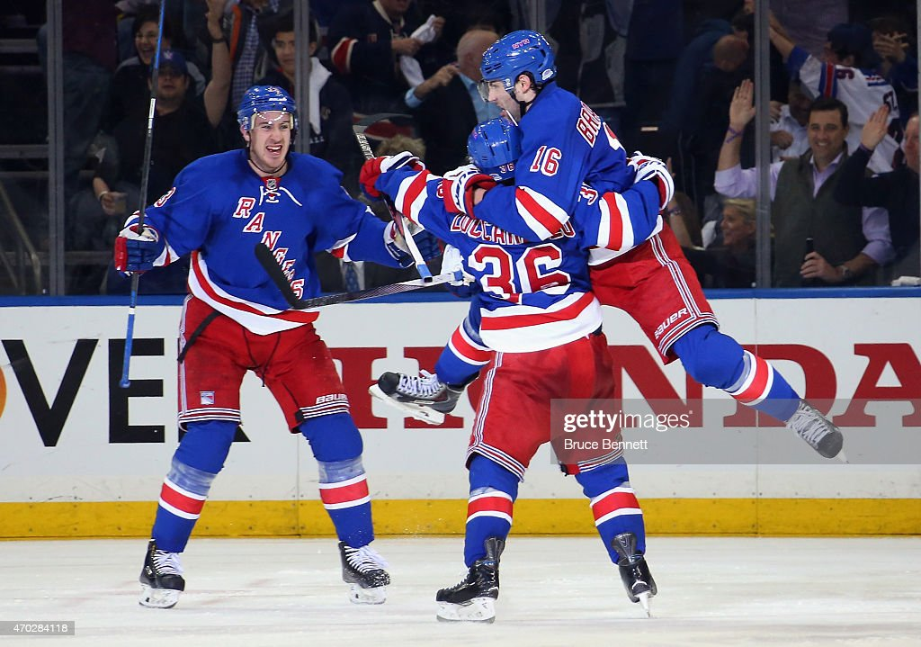 <a gi-track='captionPersonalityLinkClicked' href=/galleries/search?phrase=Derick+Brassard&family=editorial&specificpeople=540468 ng-click='$event.stopPropagation()'>Derick Brassard</a> #16 of the New York Rangers celebrates his powerplay goal at 3:16 of the third period against the Pittsburgh Penguins and is joined by <a gi-track='captionPersonalityLinkClicked' href=/galleries/search?phrase=Kevin+Hayes+-+Ice+Hockey+Player&family=editorial&specificpeople=13635523 ng-click='$event.stopPropagation()'>Kevin Hayes</a> #13 (l) and <a gi-track='captionPersonalityLinkClicked' href=/galleries/search?phrase=Mats+Zuccarello&family=editorial&specificpeople=7219903 ng-click='$event.stopPropagation()'>Mats Zuccarello</a> #36 in Game One of the Eastern Conference Quarterfinals during the 2015 NHL Stanley Cup Playoffs at Madison Square Garden on April 18, 2015 in New York City. The Penguins defeated the Rangers 4-3.