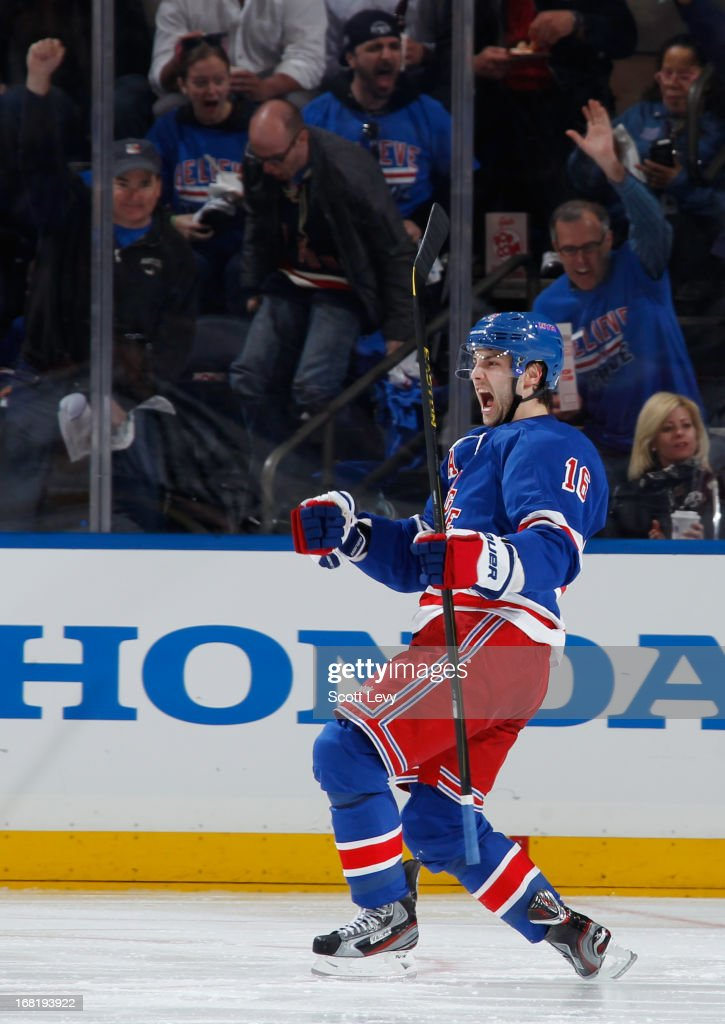 <a gi-track='captionPersonalityLinkClicked' href=/galleries/search?phrase=Derick+Brassard&family=editorial&specificpeople=540468 ng-click='$event.stopPropagation()'>Derick Brassard</a> #16 of the New York Rangers celebrates his second period goal against the Washington Capitals in Game Three of the Eastern Conference Quarterfinals during the 2013 NHL Stanley Cup Playoffs at Madison Square Garden on May 6, 2013 in New York City.