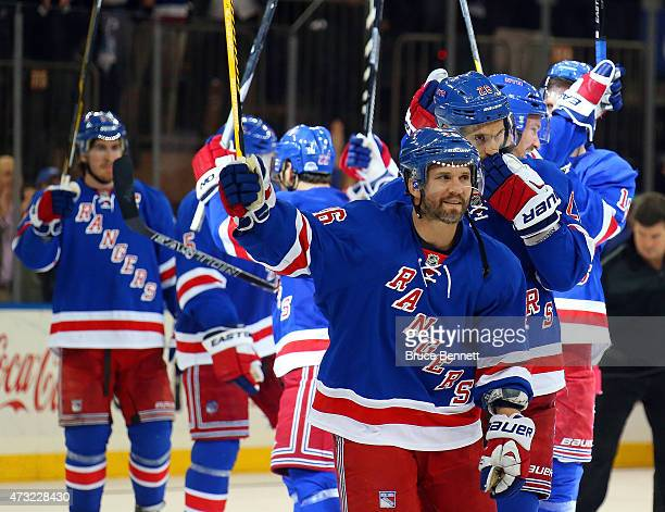 Derick Brassard of the New York Rangers celebrates with his team after defeating the Washington Capitals by a score of 201 to win Game Seven of the...