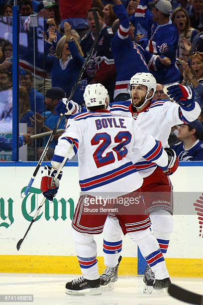 Derick Brassard of the New York Rangers celebrates with his teammate Dan Boyle after scoring the first goal in the first period against Ben Bishop of...