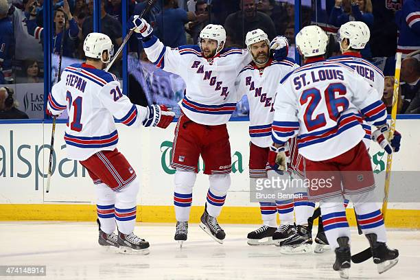 Derick Brassard of the New York Rangers celebrates with his teammates after scoring the first goal in the first period against Ben Bishop of the...