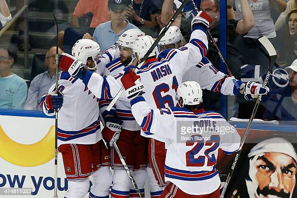 Derick Brassard of the New York Rangers celebrates with his teammates after scoring a goal against Ben Bishop of the Tampa Bay Lightning during the...