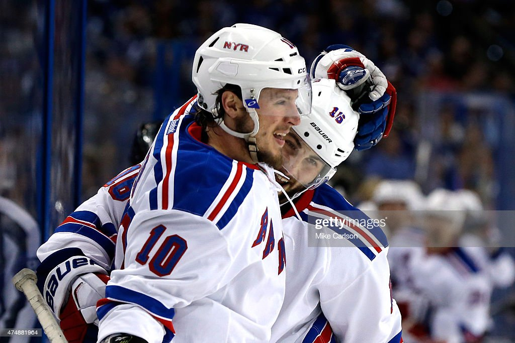 Derick Brassard of the New York Rangers celebrates with teammate JT Miller after scoring a goal against the Tampa Bay Lightning during the third...