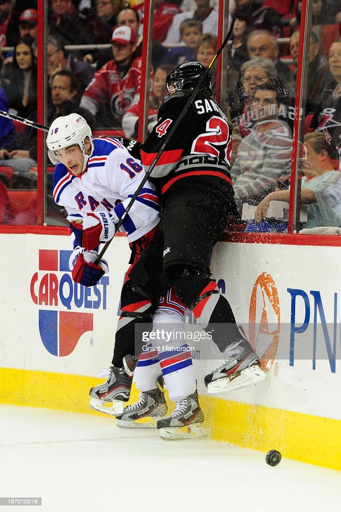 <a gi-track='captionPersonalityLinkClicked' href=/galleries/search?phrase=Derick+Brassard&family=editorial&specificpeople=540468 ng-click='$event.stopPropagation()'>Derick Brassard</a> #16 of the New York Rangers checks <a gi-track='captionPersonalityLinkClicked' href=/galleries/search?phrase=Bobby+Sanguinetti&family=editorial&specificpeople=540410 ng-click='$event.stopPropagation()'>Bobby Sanguinetti</a> #24 of the Carolina Hurricanes into the boards during play at PNC Arena on April 6, 2013 in Raleigh, North Carolina.