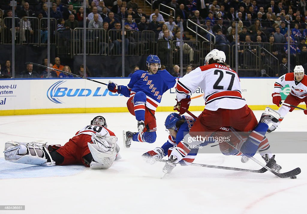 <a gi-track='captionPersonalityLinkClicked' href=/galleries/search?phrase=Derick+Brassard&family=editorial&specificpeople=540468 ng-click='$event.stopPropagation()'>Derick Brassard</a> #16 of the New York Rangers flies through the air as Ryan Haggerty #39 of the New York Rangers crashes the net and <a gi-track='captionPersonalityLinkClicked' href=/galleries/search?phrase=Cam+Ward&family=editorial&specificpeople=453216 ng-click='$event.stopPropagation()'>Cam Ward</a> #30 of the Carolina Hurricanes and Justin Faulk #27 of the Carolina Hurricanes defend during their game at Madison Square Garden on April 8, 2014 in New York City.