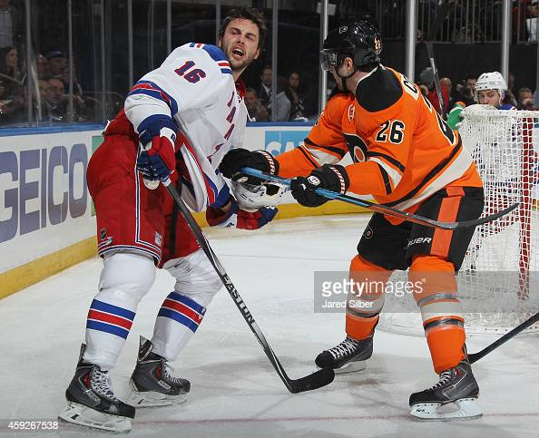Derick Brassard of the New York Rangers loses his helmet after a battle for the puck against Carlo Colaiacovo of the Philadelphia Flyers at Madison...
