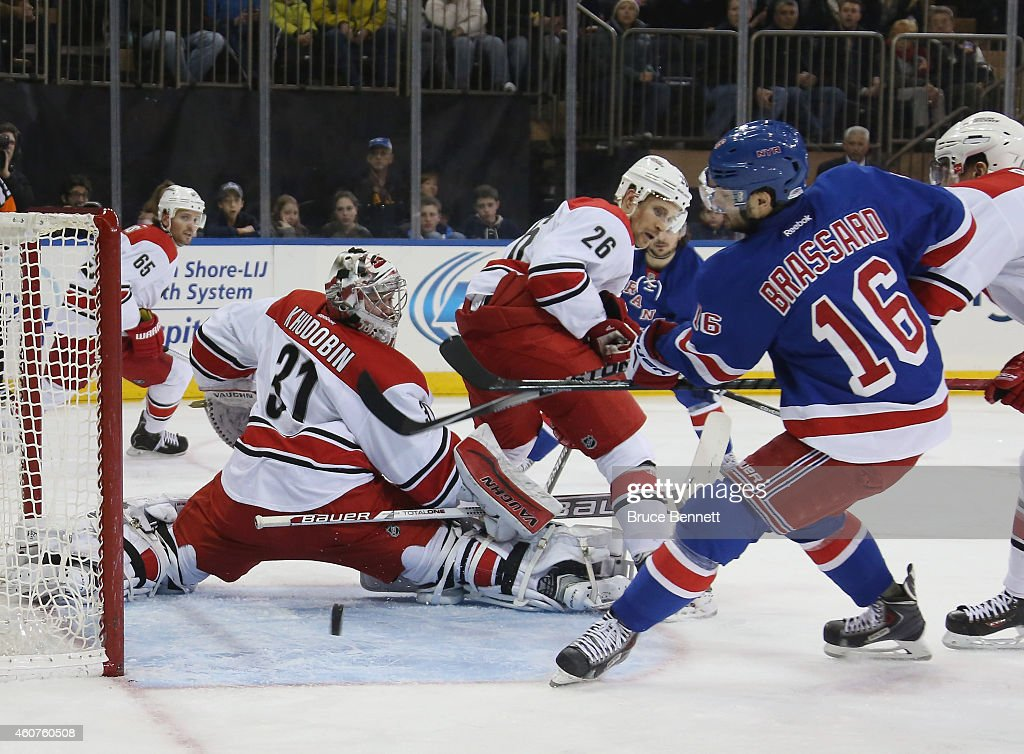 <a gi-track='captionPersonalityLinkClicked' href=/galleries/search?phrase=Derick+Brassard&family=editorial&specificpeople=540468 ng-click='$event.stopPropagation()'>Derick Brassard</a> #16 of the New York Rangers misses a second period chance against <a gi-track='captionPersonalityLinkClicked' href=/galleries/search?phrase=Anton+Khudobin&family=editorial&specificpeople=722106 ng-click='$event.stopPropagation()'>Anton Khudobin</a> #31 of the Carolina Hurricanes at Madison Square Garden on December 21, 2014 in New York City.